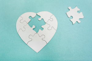 A heart shaped puzzle with missing piece